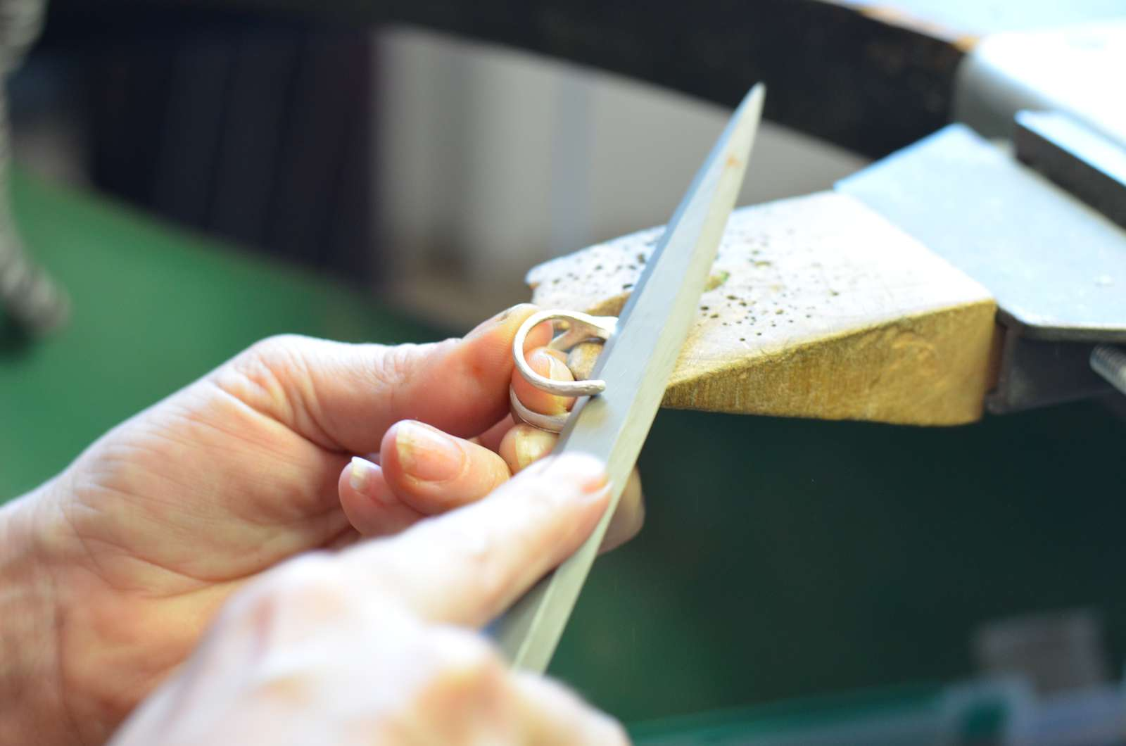 Hand making silver ring using jewellery making techniques at SquarePeg Studios in Sydney