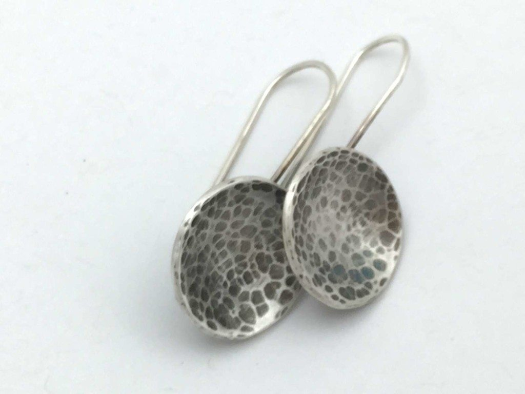Silver earrings handmade by a student in the Beginners Jewellery making class at SquarePeg Studios in Sydney