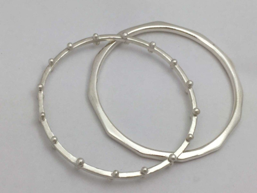 Cast silver bangles handmade by a student in the Intermediate Jewellery making class