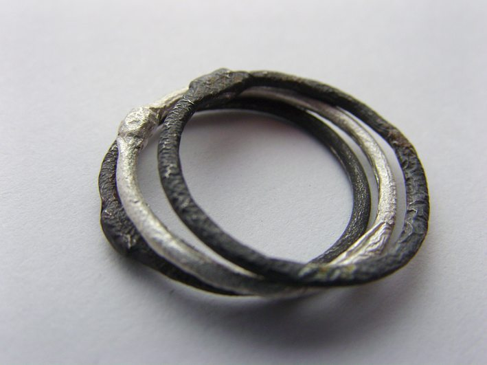 Fused and oxidised sterling silver stackable rings made by Brenda Factor