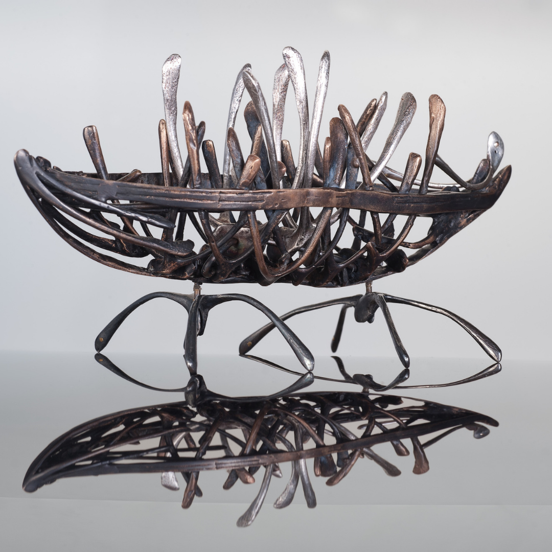 Wish Boat sculpture made with wish bones cast in metal by Fiona Meller
