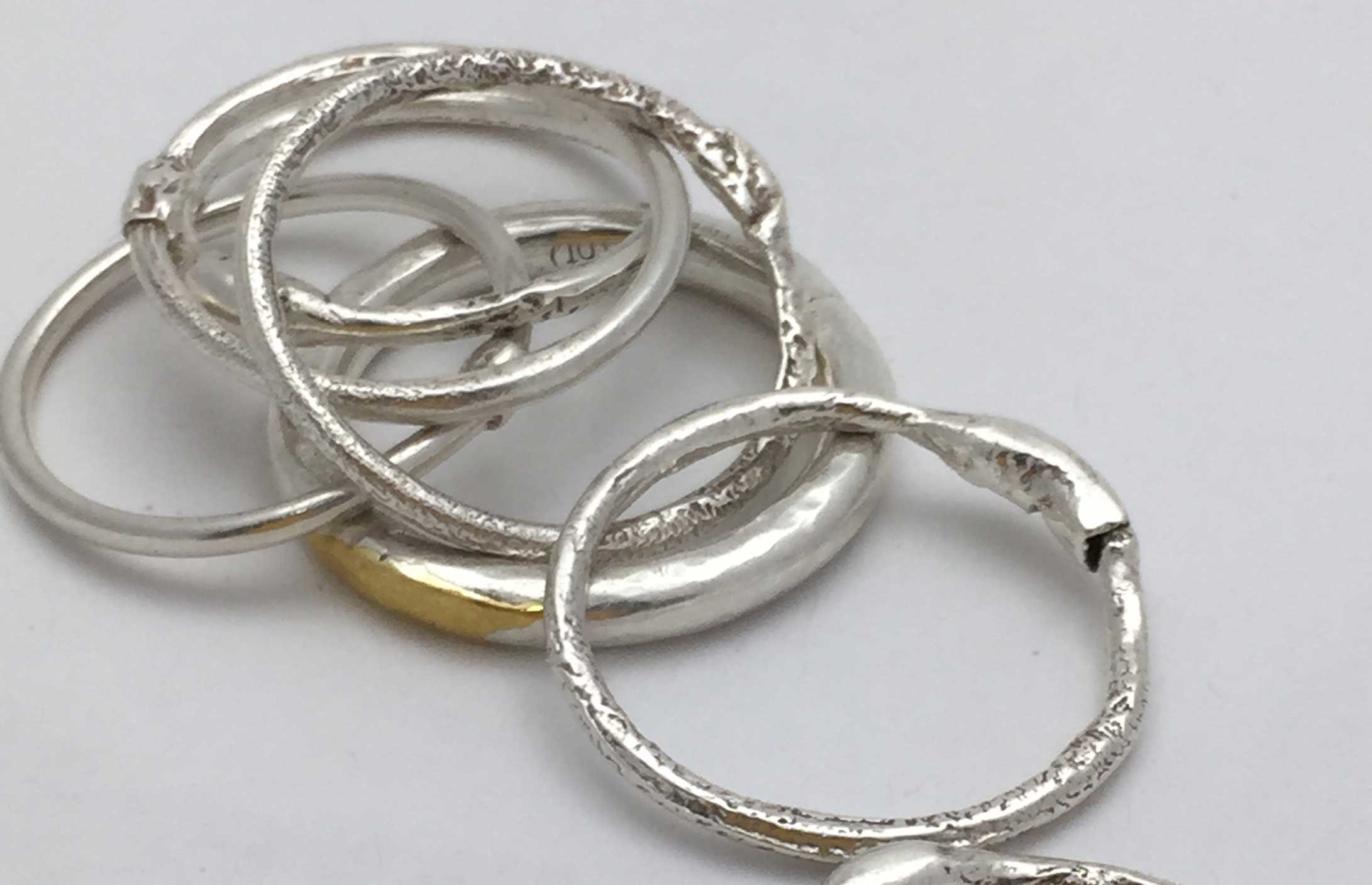 Fused silver and gold stackable rings made by Brenda Factor