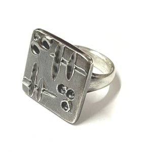 Sterling Silver ring with textured square embellishment