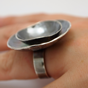 Sterling silver ring with multiple domed parts patinated black in colour