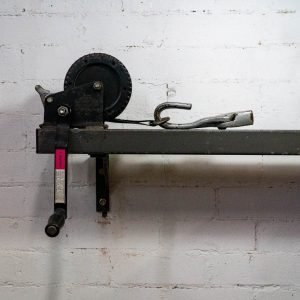 Rolling mill on white brick wall