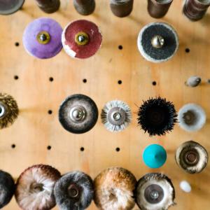 Various jewellers burs on wooden burr board