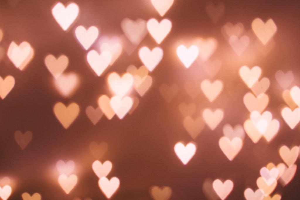pink hearts floating at night