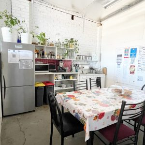 Kitchen with bright table cloth on table at SquarePeg Studios